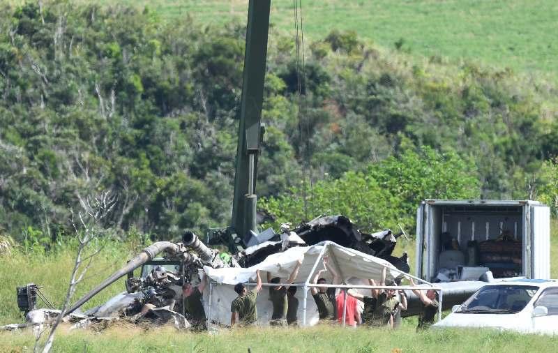 米軍ヘリ炎上:機体の残骸前に白テント設営 解体作業続く